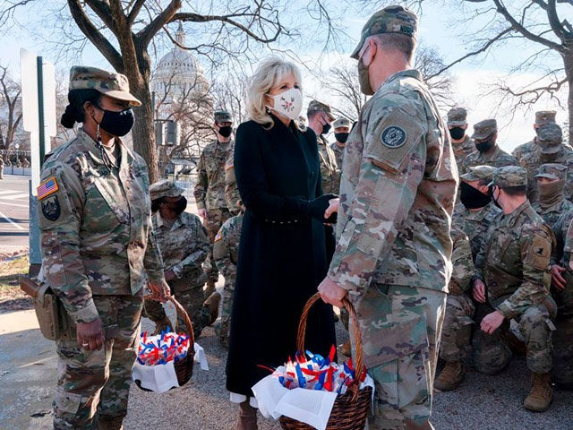 TOPSHOT - Saying, The Bidens are a National Guard family, first lady Jill Biden greets members of the National Guard with chocolate chip cookies outside the Capitol on January 22, 2021, in Washington, DC. (Photo by Jacquelyn Martin / POOL / AFP) (Photo by JACQUELYN MARTIN/POOL/AFP via Getty Images)