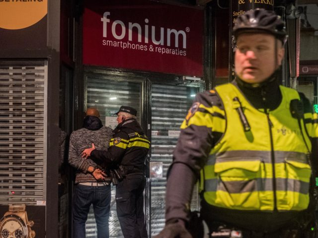 NIJMEGEN, NETHERLANDS - JANUARY 25: A man is arrested at Plein 1944, the central square where riots were announced on January 25, 2021 in Nijmegen, Netherlands. Over 200 people were detained after Sunday's protest saw demonstrators clash with police, who deployed water cannon to disperse crowds. (Photo by Sanne Derks/Getty …