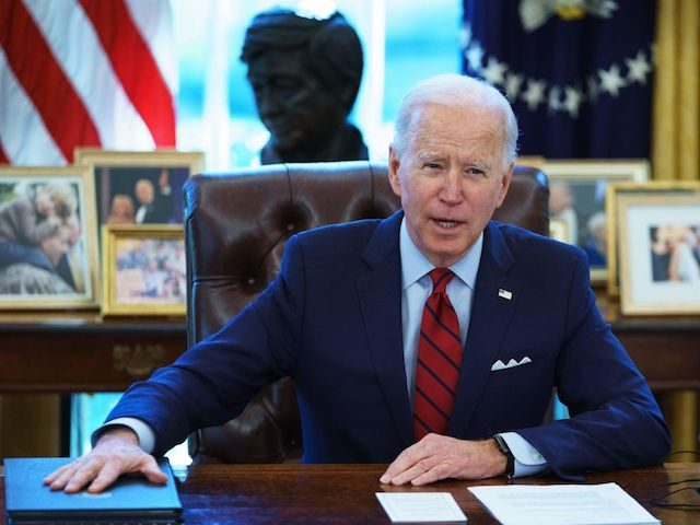 US President Joe Biden speaks before signing executive orders on health care, in the Oval Office of the White House in Washington, DC, on January 28, 2021. - The orders include reopening enrollment in the federal Affordable Care Act. (Photo by MANDEL NGAN / AFP) (Photo by MANDEL NGAN/AFP via …