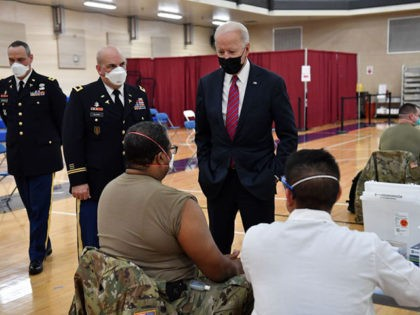 US President Joe Biden (R), flanked by the Director of Walter Reed National Military Medical Center, Col. Andrew Barr (C), visits a coronavirus vaccination site at Walter Reed National Military Medical Center in Bethesda, Maryland, on January 29, 2021. (Photo by Nicholas Kamm / AFP) (Photo by NICHOLAS KAMM/AFP via …
