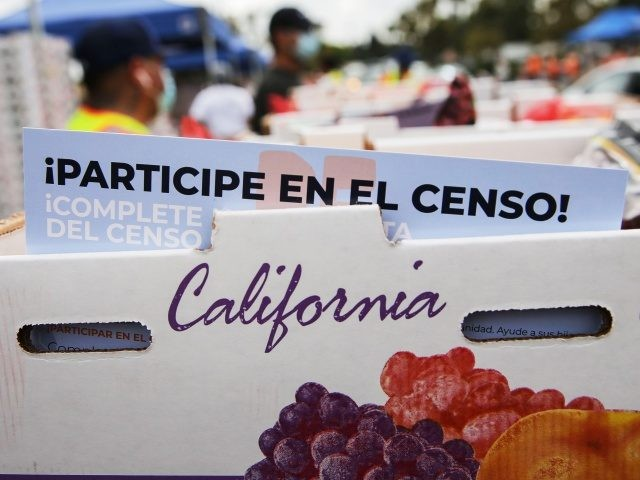 PARAMOUNT, CALIFORNIA - AUGUST 06: A pamphlet with 2020 census information written in Spanish is included in a box of food to be distributed by the Los Angeles Regional Food Bank to people facing economic or food insecurity amid the COVID-19 pandemic on August 6, 2020 in Paramount, California. Around …