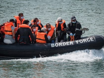 DOVER, ENGLAND - AUGUST 11: Migrants arrive in port aboard a Border Force vessel after being intercepted while crossing the English Channel from France in small boats on August 11, 2020 in Dover, England. In recent weeks large numbers of migrants have travelled in small boats across the English channel, …