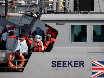 DOVER, ENGLAND - SEPTEMBER 22: Migrants on board HMC Seeker after being intercepted in the English Channel by border foce on September 22, 2020 in Dover, England. This summer has seen an increase in people making the journey in small crafts from France seeking asylum in U.K. (Photo by Luke …