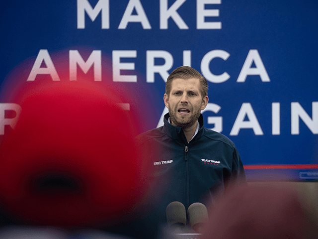 President Donald Trump's son Eric Trump addresses supporters at a rally on October 29, 2020 in Lansing, Michigan. Eric Trump spoke to about 60 Trump supporters at an outdoor sports complex in the final week before the U.S. presidential election. (Photo by John Moore/Getty Images)