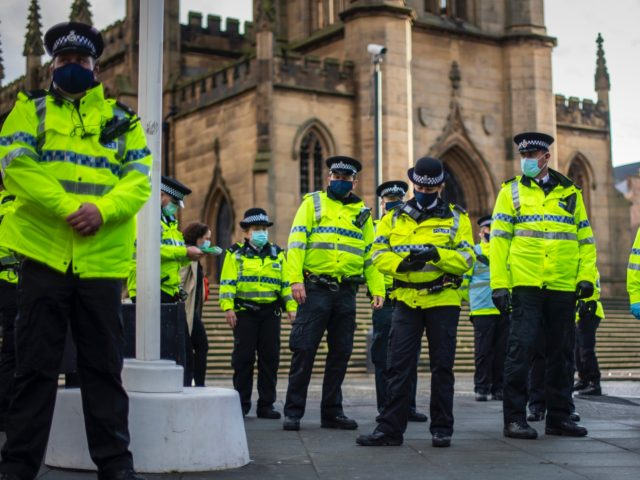 LIVERPOOL, ENGLAND - NOVEMBER 14: Police officers patrol Bold Street during an anti lockdown protest on November 14, 2020 in Liverpool, England. Throughout the Covid-19 pandemic, there have been recurring protests across England against lockdown restrictions and other rules meant to curb the spread of the virus. Police in Liverpool …