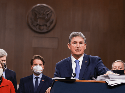 Sen. Joe Manchin (D-WV) speaks alongside a bipartisan group of Democrat and Republican members of Congress as they announce a proposal for a Covid-19 relief bill on Capitol Hill on December 14, 2020 in Washington, DC. Lawmakers from both chambers released a $908 billion package Monday, split into two bills. …