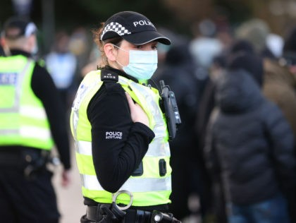 GLASGOW, SCOTLAND - DECEMBER 20: A Police officer wearing a protective mask is seen outside the stadium prior to the William Hill Scottish Cup final match between Celtic and Heart of Midlothian at Hampden Park National Stadium on December 20, 2020 in Glasgow, Scotland. The match will be played without …