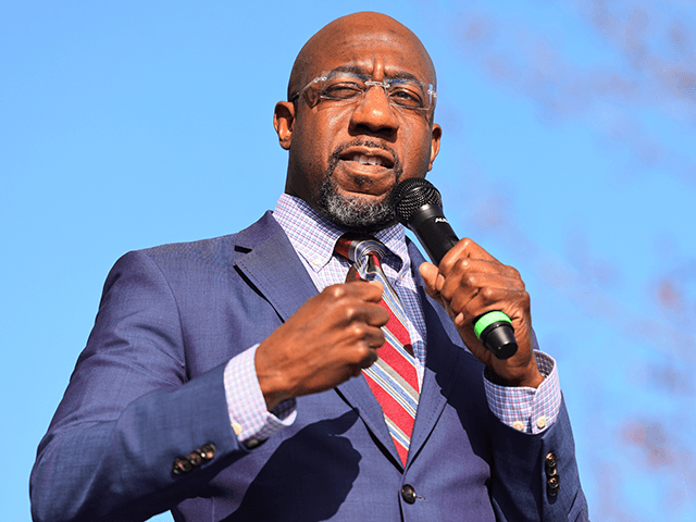 Georgia Democratic Senate candidate Rev. Raphael Warnock speaks at an Augusta canvass launch block party at Robert Howard Community Center on January 04, 2021 in Hephzibah, Georgia. On the final day before the January 5th runoff election, Warnock and Ossoff, who are challenging Republican incumbent senators Kelly Loeffler and David …
