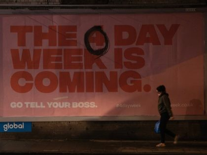 LONDON, ENGLAND - JANUARY 05: A billboard advertising a four day week, that has been altered to say 'The 0 day week is coming' on January 05, 2021 in London, England. British Prime Minister made a national television address on Monday evening announcing England is to enter its third coronavirus …