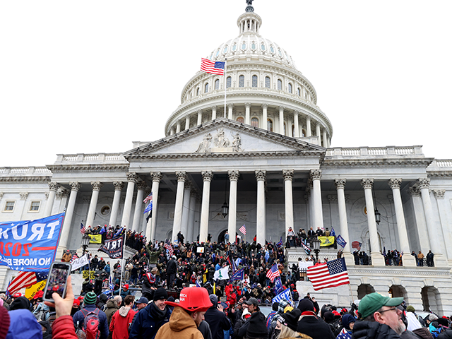 Protesters gather on the U.S. Capitol Building on January 06, 2021 in Washington, DC. Pro-Trump protesters entered the U.S. Capitol building after mass demonstrations in the nation's capital during a joint session Congress to ratify President-elect Joe Biden's 306-232 Electoral College win over President Donald Trump. (Photo by Tasos Katopodis/Getty …