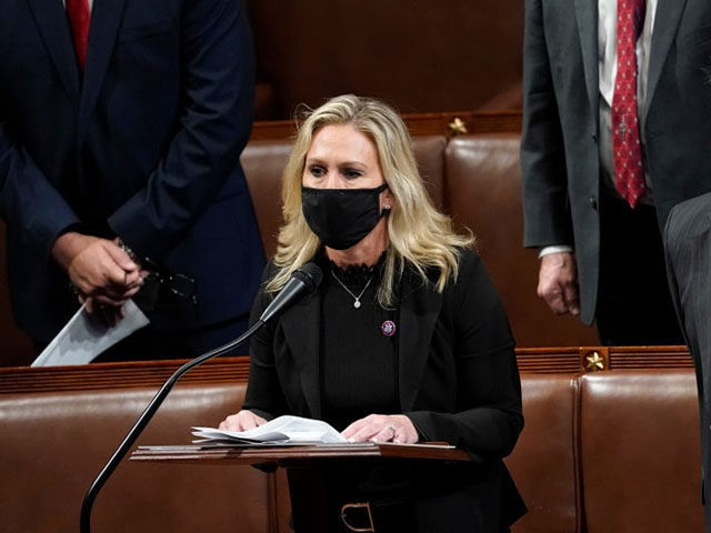 WASHINGTON, DC - JANUARY 06: U.S. Rep. Marjorie Taylor Greene (R-GA) speaks on the floor of the House Chamber during a reconvening of a joint session of Congress on January 06, 2021 in Washington, DC. Members of Congress returned to the House Chamber after being evacuated when protesters stormed the …