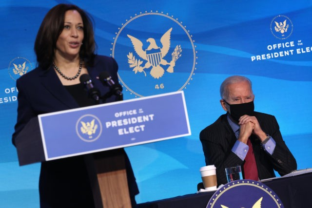 WILMINGTON, DELAWARE - JANUARY 08: U.S. President-elect Joe Biden (R) looks on as U.S. Vice President-elect Kamala Harris (L) delivers remarks after announcing nominees of his cabinet that will round out his economic team, including secretaries of commerce and labor, at The Queen theater on January 08, 2021 in Wilmington, …