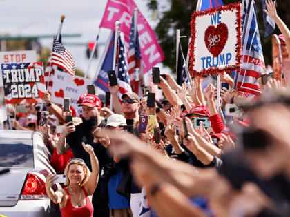 Supporters wave to outgoing US President Donald Trump as he returns to Florida along the route leading to his Mar-a-Lago estate on January 20, 2021 in West Palm Beach, Florida. Trump, the first president in more than 150 years to refuse to attend his successor's inauguration, is expected to spend …