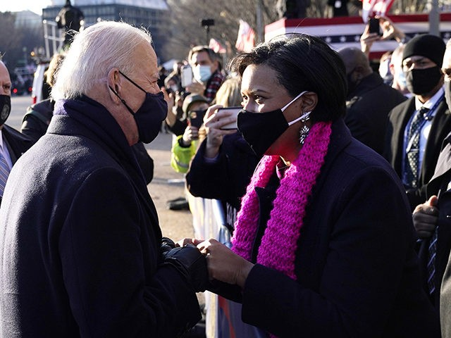 WASHINGTON, DC - JANUARY 20: U.S. President Joe Biden greets DC Mayor Muriel Bowser on the abbreviated parade route after Biden's inauguration on January 20, 2021 in Washington, DC. Biden became the 46th president of the United States earlier today during the ceremony at the U.S. Capitol. (Photo by Drew …