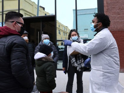 NEW YORK, NEW YORK - JANUARY 22: A medical worker stands outside of a mobile COVID-19 testing lab in Brooklyn as the city begins to run low on the vaccine doses on January 22, 2021 in New York City. Mayor Bill de Blasio announced at a press conference that New …