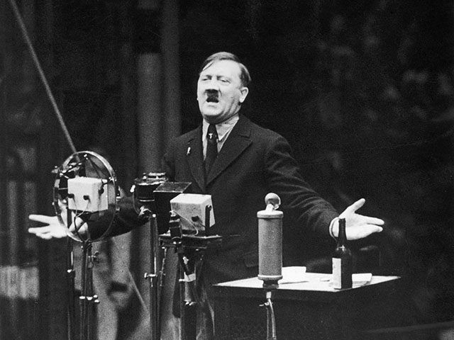 1935: Nazi leader Adolf Hitler speaks in front of microphones and gestures with his hands. Original Publication: From the newsreel 'The March of Time'. (Photo by Hulton Archive/Getty Images)