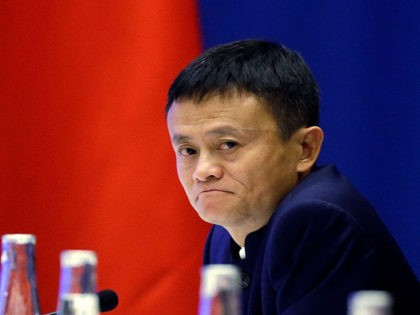 SEATTLE, WA - SEPTEMBER 23: Jack Ma, CEO of Alibaba listens as Chinese President Xi Jinping speaks at a U.S.-China business roundtable, comprised of U.S. and Chinese CEOs on September 23, 2015, in Seattle, Washington. The Paulson Institute, in partnership with the China Council for the Promotion of International Trade, …
