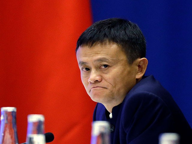 SEATTLE, WA - SEPTEMBER 23: Jack Ma, CEO of Alibaba listens as Chinese President Xi Jinping speaks at a U.S.-China business roundtable, comprised of U.S. and Chinese CEOs on September 23, 2015, in Seattle, Washington. The Paulson Institute, in partnership with the China Council for the Promotion of International Trade, co-hosted the event. (Photo by Elaine Thompson-Pool/Getty Images)