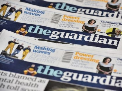 The Guardian newspaper is to cut running costs by 20 percent over three years and may begin charging for some online content following a 25-percent plunge in print advertising, British media reported Tuesday. / AFP / BEN STANSALL (Photo credit should read BEN STANSALL/AFP via Getty Images)
