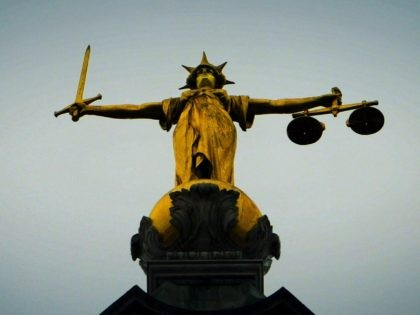LONDON - DECEMBER 12: A statue of the scales of justice stands high above the Old Bailey on December 12, 2003 in London. Ian Huntley is accused of murdering youngsters Jessica Chapman and Holly Wells, his ex-girlfriend Maxine Carr is accused of conspiring to pervert the course of justice. (Photo …