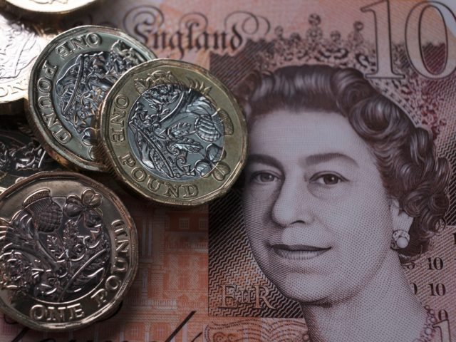 BATH, ENGLAND - OCTOBER 13: In this photo illustration, £1 coins are seen with the new £10 note on October 13, 2017 in Bath, England. Currency experts have warned that as the uncertainty surrounding Brexit continues, the value of the British pound, which has remained depressed against the US dollar …
