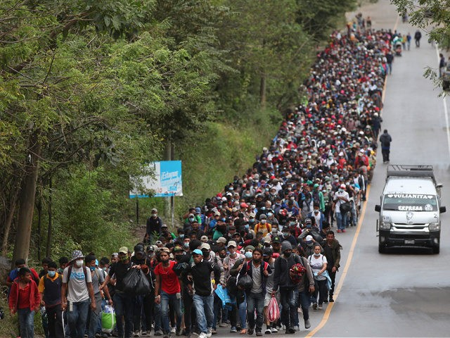 Honduran migrants hoping to reach the U.S. border walk alongside a highway in Chiquimula, Guatemala, Saturday, Jan. 16, 2021. Guatemalan authorities estimated that as many as 9,000 Honduran migrants have crossed into Guatemala as part of an effort to form a new caravan to reach the U.S. border. (AP Photo/Sandra …