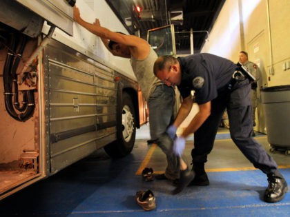 PHOENIX - APRIL 28: An undocumented Mexican immigrant is searched while being in-processed at the Immigration and Customs Enforcement (ICE), center on April 28, 2010 in Phoenix, Arizona. Across Arizona, city police and county sheriffs' departments turn over detained immigrants to ICE, which deports them to their home countries. Last …