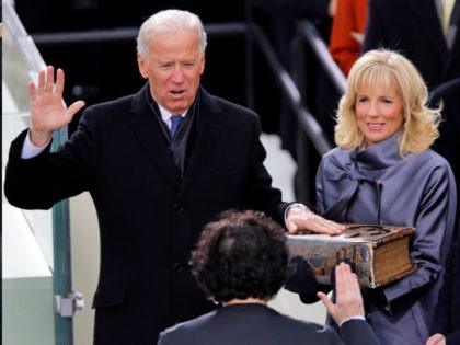 Vice President Joe Biden takes the oath of office from Associate Justice Sonia Sotomayor as Jill Biden looks on during the ceremonial swearing-in at the U.S. Capitol during the 57th Presidential Inauguration in Washington, Monday, Jan. 21, 2013. (AP Photo/Evan Vucci)