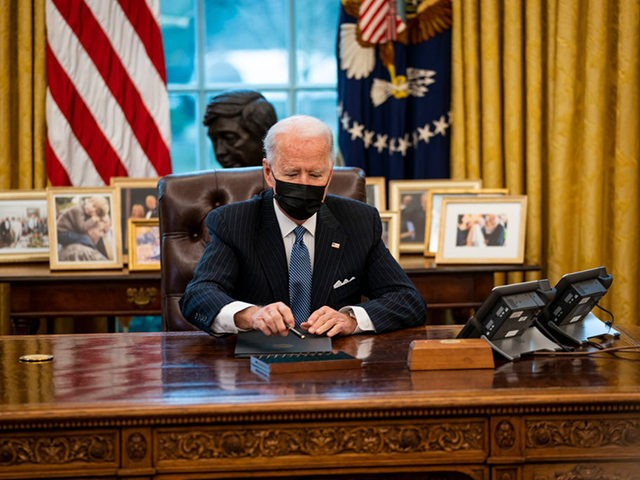 WASHINGTON, DC - JANUARY 25: U.S. President Joe Biden prepares to sign an executive order in the Oval Office of the White House on January 25, 2021 in Washington, DC. President Biden signed an executive order repealing the ban on transgender people serving openly in the military. (Photo by Doug …
