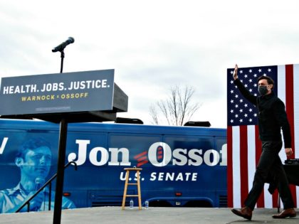 "STONECREST, GA - DECEMBER 28: Georgia Democratic Senate candidate Jon Ossoff waves to the crowd gathered for a ""It's Time to Vote"" drive-in rally on December 28, 2020 in Stonecrest, Georgia. With a week until the January 5th runoff election that will determine control of the Senate, candidates continue to …"