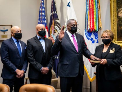 WASHINGTON, DC - JANUARY 25: Secretary of Defense Lloyd Austin participates in a ceremonial swearing-in with U.S. Vice President Kamala Harris (not pictured) in the Roosevelt Room of the White House on January 25, 2021 in Washington, DC. On Monday, President Biden signed an executive order repealing the ban on …