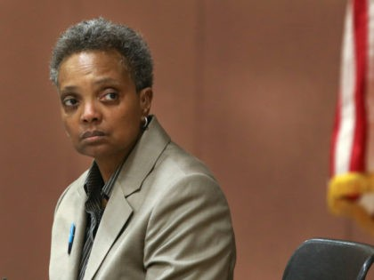 In this March 24, 2019 photo, Chicago mayoral candidate Lori Lightfoot listens to a question during a candidate forum sponsored by One Chicago For All Alliance at Daley College in Chicago. Lightfoot and Toni Preckwinkle are competing to make history by becoming the city's first black, female mayor. On issues …