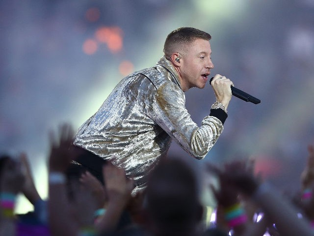 SYDNEY, AUSTRALIA - OCTOBER 01: Macklemore performs before the 2017 NRL Grand Final match between the Melbourne Storm and the North Queensland Cowboys at ANZ Stadium on October 1, 2017 in Sydney, Australia. (Photo by Mark Kolbe/Getty Images)