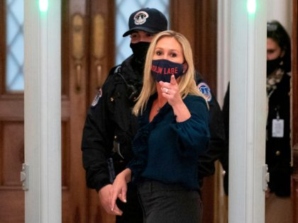 Representative Marjorie Taylor Greene (R-GA) shouts at journalists as she goes through security outside the House Chamber at Capitol Hill in Washington, DC on January 12, 2021. - On the eve of his likely impeachment, President Donald Trump on Tuesday denied responsibility for the storming of Congress by a mob …