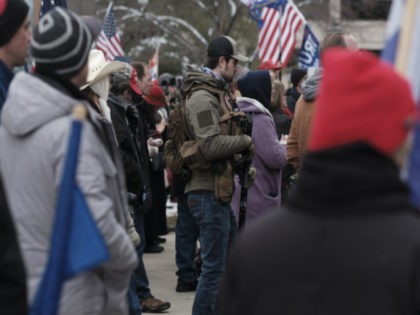 Donald Trump supporters gather around the Michigan State Capitol Building to protest the certification of Joe Biden as the next president of the United states on January 6, 2021 in Lansing, Michigan. Trump supporters gathered at state capitals across the country to protest today's ratification of President-elect Joe Biden's Electoral …