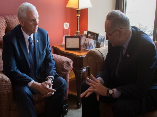 Vice President-elect Mike Pence meets with Senator Chuck Schumer (R), D-New York, in his office on Capitol Hill in Washington, DC, November 17, 2016. / AFP / JIM WATSON (Photo credit should read JIM WATSON/AFP via Getty Images)