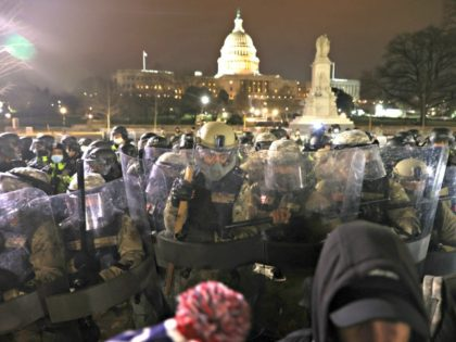 WASHINGTON, DC - JANUARY 06: Members of the National Guard assist police officers in dispersing protesters who are gathering at the U.S. Capitol Building on January 06, 2021 in Washington, DC. Pro-Trump protesters entered the U.S. Capitol building after mass demonstrations in the nation's capital during a joint session Congress …