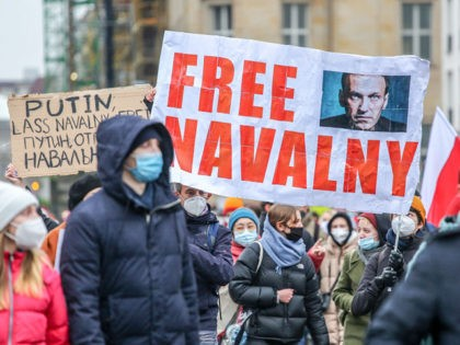 "BERLIN, GERMANY - JANUARY 23: Protesters hold a banner reading ""FREE NAVALNY"" as some 2,500 supporters of Russian opposition politician Alexei Navalny march in protest to demand his release from prison in Moscow on January 23, 2021 in Berlin, Germany. The protesters marched from the federal chancellery through the Russian …"
