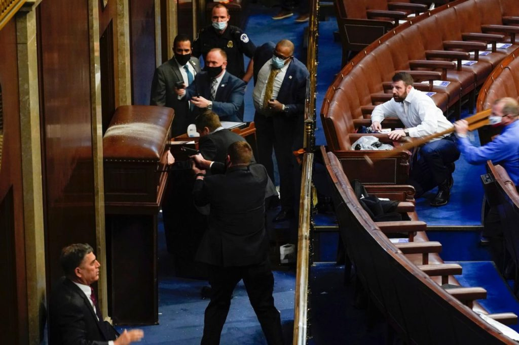 Nehls Charges Protesters with Table Leg to Defend House Chamber AP Andrew Harnik