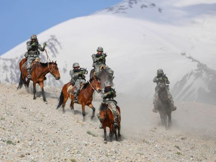 Chinese People's Liberation Army (PLA) soldiers take part in a training session at Pamir Mountains in Kashgar, in China's western Xinjiang region on August 28, 2020. (Photo by STR / AFP) / China OUT (Photo by STR/AFP via Getty Images)