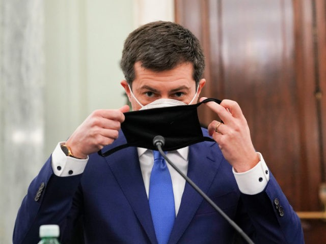 Pete Buttigieg, U.S. secretary of transportation nominee for U.S. President Joe Biden, puts on a protective mask during a Senate Commerce, Science and Transportation Committee confirmation hearing on January 21, 2021 in Washington, D.C. Buttigieg, is pledging to carry out the administration's ambitious agenda to rebuild the nation's infrastructure, calling …