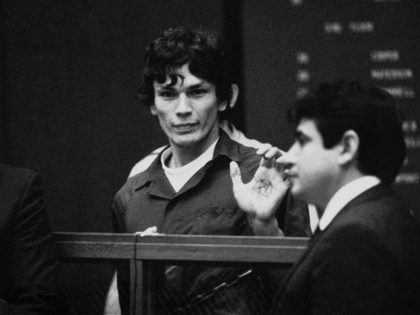 FILE-This 1985 file photo shows Richard Ramirez, center, know as the Night Stalker shows a pentagram on the palm of his hand in court. California corrections officials say convicted serial killer Ramirez, known as the Night Stalker, has died in prison. San Quentin State Prison spokesman Lt. Sam Robinson says …