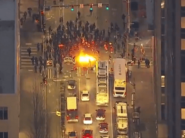 Antifa sets fires on blocked streets in downtown Seattle following the inauguration of President Joe Biden. (Video Screenshot/KOMO News)