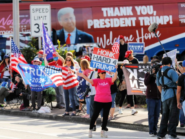 WEST PALM BEACH, FLORIDA - JANUARY 20: Supporters of outgoing US President Donald Trump await his return to Florida along the route leading to his Mar-a-Lago estate on January 20, 2021 in West Palm Beach, Florida. Trump, the first president in more than 150 years to refuse to attend his …