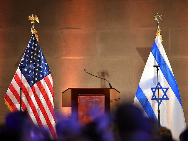 The US and Israeli flags are pictured at the Israeli Embassy's independence day celebration in Washington on May 22, 2019