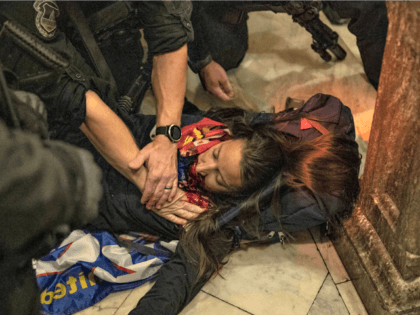 A woman is wounded on the ground after being shot during a protest at the U.S. Capitol today. Victor J. Blue/Bloomberg via Getty Images