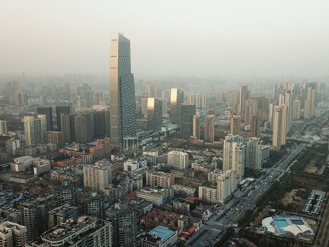 WUHAN, CHINA - JANUARY 28: An aerial view of the city sunset on January 28, 2021 in Wuhan, China. In order to curb the spread of the new crown pneumonia COVID-19 disease, the Chinese government closed the city of Wuhan for 76 days starting January 23, 2020. (Photo by Lintao …