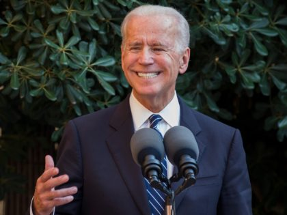 US Vice President Joe Biden smiles as he speaks at Ledra palace in the UN-patrolled Buffer Zone in Nicosia on May 22, 2014. Biden met Cyprus leaders Thursday to spur talks on ending the island's 40-year division and seek support for threatened sanctions against Russia despite the economic cost. AFP …