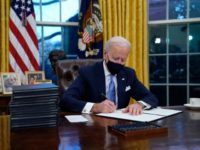 Biden Signs Stack of Executive Orders to Roll Back Trump Agenda