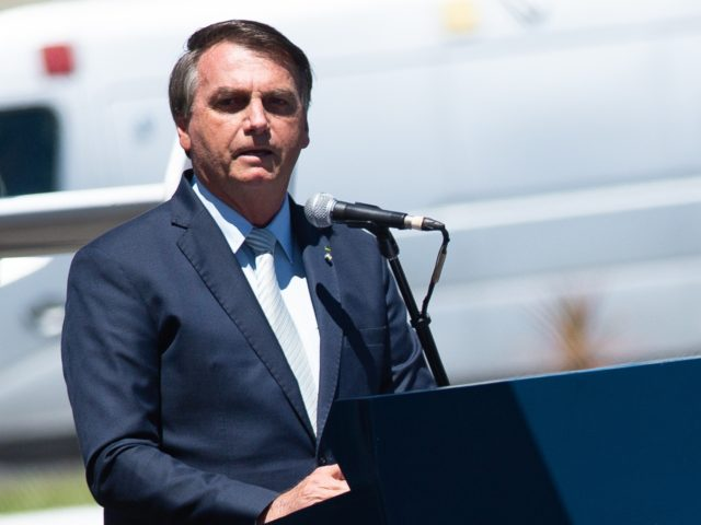 BRASILIA, BRAZIL - JANUARY 20: Jair Bolsonaro, President of Brazil, reacts during the Air Force 80th Anniversary Celebration amidst the Coronavirus (COVID - 19) pandemic at the Brazilian Air Force Base on January 20, 2021 in Brasilia. Brazil has over 8.570,000 confirmed positive cases of Coronavirus and has over 211,491 deaths. (Photo …
